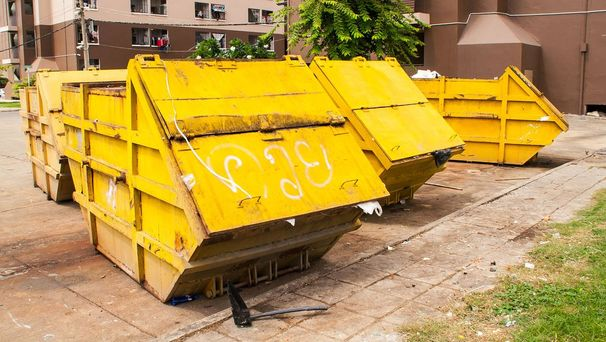 Skips outside a block of flats