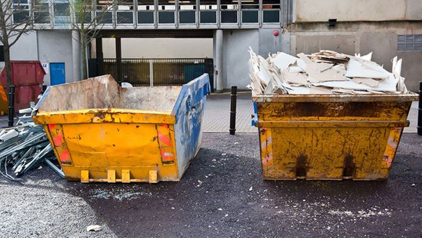 Two skips on a building site